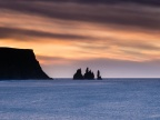 The Sunrise Over The Basalt Sea Stacks Of Reynisdrangar